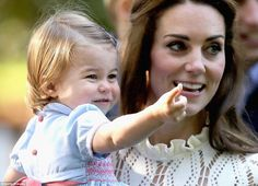 Princess Charlotte, pictured in the arms of her mother Kate, stole the show by uttering he...