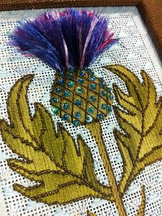 Thistle needlepoint by KreinikGirl, via Flickr. Stitch guide by Robin King, needlepoint canvas by Zecca.