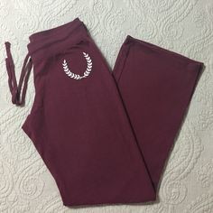 Super soft pj/lounge pants Burgundy pants are super soft. Perfect for pj pants or just for lounging around. They are super comfy. Size Medium with drawstring waist. Only worn 1-2 times, really good condition. 63% Polyester33% Rayon 4% Spandex. Machine washable. Pants