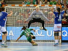 Dorina Korsos (11) of Hungary's Gyori Audi ETO KC scores against goalkeeper Clara Woltering of Montenegro's RK Buducnost. Gyori won 27-21 to capture the European Handball championship. (via Leading Off: Pictures of the Week - Photos - SI.com -)
