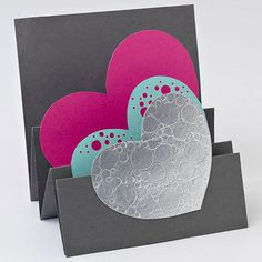 What better way to show Mom how much you love her than to give her a handmade card full of hearts? Simply fold a plain, rectangular-shaped piece of cardstock multiple times on one end, and glue heart cutouts to each fold. Choose multiple colors for the hearts or write a message with a metallic pen to personalize this Mother's Day card.