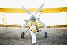 stormy day plane hangar wedding - photo by Sarah Tamagni Photography http://ruffledblog.com/stormy-day-plane-hangar-wedding