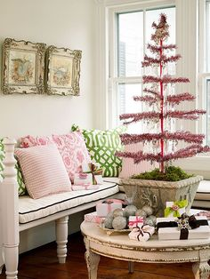 I love how they covered the base of the tree with moss and put it in a pot. PRETTY!     And pink & spring green instead of the traditional red & green? Why not? It is fresh and pretty.