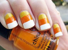 This candy corn manicure is perfect for Halloween.