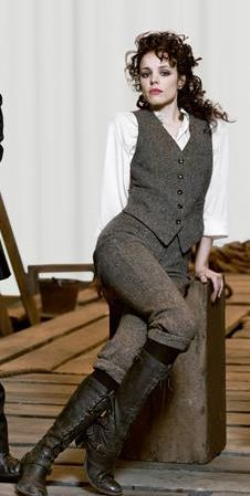 White shirt, tweed vest (w/red back), tweed knickers, tall practical boots.