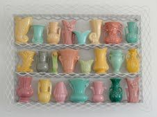 This is a beautiful collection of vintage #pottery. I love the idea of grouping them all on a wire shelf as well.. now to find one...