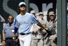 American League pitcher Yu Darvish, from the Texas Rangers, warms up before the MLB All-Star baseball game, Tuesday, July 10, 2012, in Kansas City, Mo. (AP Photo/Jeff Roberson)