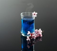 """Sky tea sweetened with foraged wild plum blossom cordial and served with coconut milk """"clouds."""" Image use with permission of @betsy.hinze www.betsyhinze.com"""