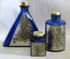 pewter bottles decorated for bathroom corner