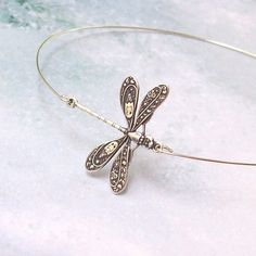 A lovely filigree oxidized silver plate dragonfly sets off a hypo allergenic, silver plated, stainless steel wire band. Ive used a very