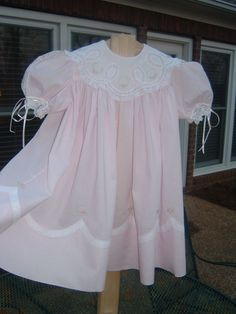 Batiste dress with lace shaped collar, scalloped insertion at hem and sleeves with insertion. Beautiful portrait or Easter dress.
