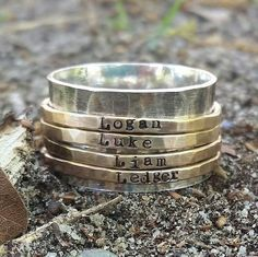 Personalized gold spinner ring, Hand stamped ring, Sterling silver ring, fidget ring, mothers ring, engraved mothers ring, wedding band by JillAllenDesign on Etsy https://www.etsy.com/listing/257294070/personalized-gold-spinner-ring-hand