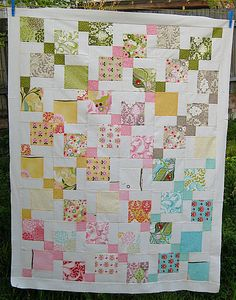 charm pack quilt using disappearing 9 patch quilt blocks. I've made one of these style quilts.  We called it Tossed Nine Patch.  Love it!