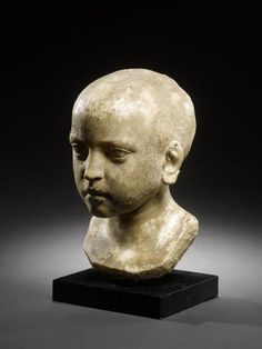 A Roman marble bust of a child  Egypt, circa 2nd Century A.D.
