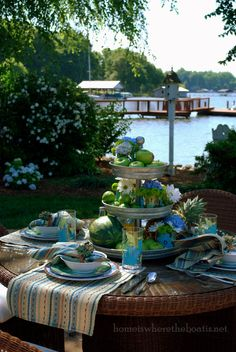 Alfresco dining and galvanized tiered server centerpiece | homeiswheretheboatis.net #tablescape