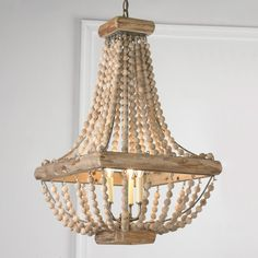 "Wood Bead Chandelier From romantic bedrooms to garden solarium spaces, this wood bead chandelier helps you lighten up!. Square distressed wood frame holds 20 natural wood bead strands.3x40 watts candle sockets. (28""Hx16""W) 4.5"" antique brass canopy. 6' antique brass chain."