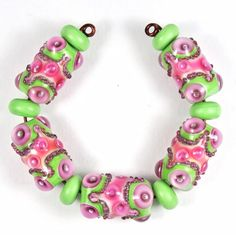 Pink and Green Handmade Lampwork Bead Set by catlampwork on Etsy https://www.etsy.com/listing/209836652/pink-and-green-handmade-lampwork-bead