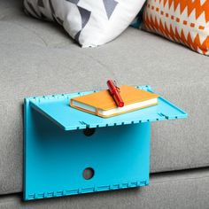Urban Shelf provides a surface for anything you need within arm's reach. Foldable and lightweight, it doubles as a stand for a tablet or an e-reader too!