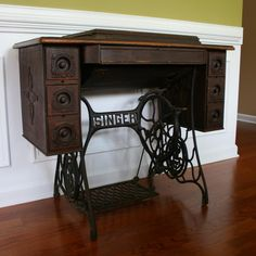 Years ago i saw a antique sewing machine and table like this in a have something very similar in my living room vintage singer treadle sewing machine table watchthetrailerfo