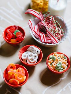 Set out bowls of Christmas candy alongside ribbons and string to encourage pint-sized guests to creat their own (edible!) bracelets and necklaces.