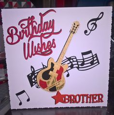 Made by Val Callaghan - This card was made from the Tonic music collection, also Tonic family sentiments and birthday die, for my brother who plays guitar in a band.