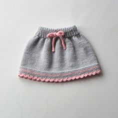 Lovely hand knit baby girl ski