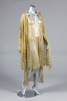 A tunic formed from a 1920's yellow Azuite stole, stamped overall with silver patterns; together with a yellow stole stamped in gold.