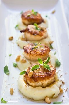 Seared scallops over parsnip puree. Seared scallops over parsnip puree - buttery scallops served atop a luscious sweet parsnip puree spiced with nutmeg & toasted pine nuts. Fish Recipes, Seafood Recipes, Gourmet Recipes, Cooking Recipes, Gourmet Desserts, Gourmet Foods, Gourmet Food Plating, Appetizer Recipes, Plated Desserts