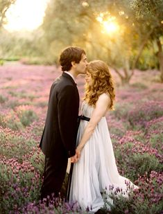 love this.. the dress AMAZING!... field of flowers!!... forehead kisses <3