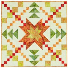 This bright quilt, perfect as a table topper or wall hanging, features a  blazing star of fiery red, yellows, and orange batiks. The star shines  against a pale green background.