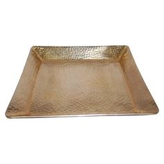 Picture this Threshold Squared Hammered Tray with Gold Finish front and center on your dining table. Made of hammered aluminum, this gorgeous gold tray can be used for everything from serving your culinary concoctions to displaying your collection of candles. This serving tray has a lacquered finish, giving it a golden shine. With multiple uses and functions, this metal tray offers a double threat of function and style. Hand wash.