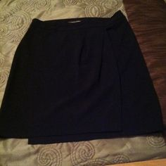 "⏰SALE Adrienne Vittadini Black Skirt Sz 8 This is a 64% polyester 32% Rayon and 4% spandex skirt. Waist to hem is 20"".  There is a pleated flap in the front and a stitched up pocket in the back. Zips and buttons on the left side.  Really pretty. Adrienne Vittadini Skirts"