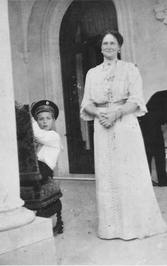 ...A rare smiling Alexandra...with her son, the rather peevish and ill-mannered Tsarevitch...