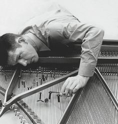 Cage preparing a piano, in 1947. good article on Cage