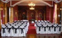 The Grand Ballroom, Haigh Hall dressed in the weddings black and white theme.  White chair covers with black organza sash.  www.am-flowers.co.uk