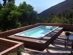 Swim Spa Photo Gallery -- building a deck up and around?