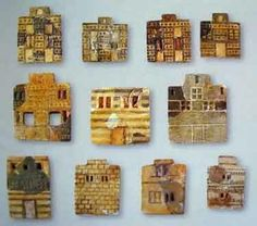 More faience plaques depicting Minoan houses.