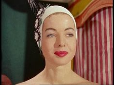 Swimming Cap Fashions (1950s)?..note the hats worn by the audience as well...this ad is definitely from the past.