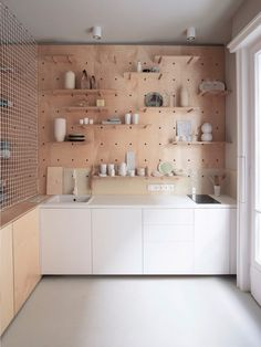 clever pegboard shelving that can easily be adjusted
