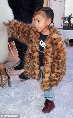 Trend setters: while their moms fill their wardrobes, it's up to North and Penelope to pic...