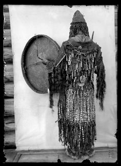 AMNH Image Collection | Yukaghir shaman in ceremonial dress [with drum], Siberia, Russia, 1902