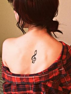 I love the placement of this tattoo. I wouldn't get the treble clef on my back though
