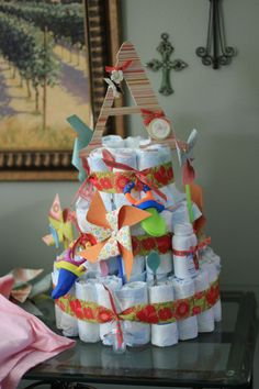 diaper cake - baby shower decoration idea (reusable stuff and pretty)