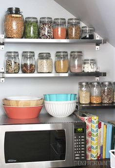Our pantry makeover reveal! A creative DIY pantry using IKEA shelves and organized with baskets, bins and glass jars! #pantry #kitchen #organization