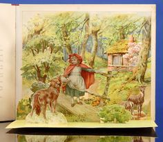 LITTLE RED RIDING HOOD Ernest Nister was a printer and publisher based in Nuremberg, Germany. He established a London office in 1888 under the direction of the writer Robert Ellice Mack and, specializing in children's literature, soon issued pop-up, movable, transformation, and panorama books, as well as standard children's fare, operating until 1917.