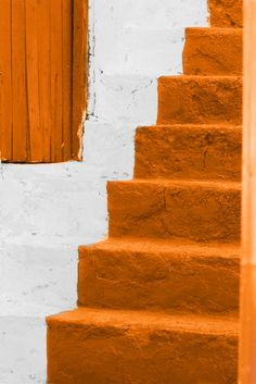 Orange home. Stairs in white and orange