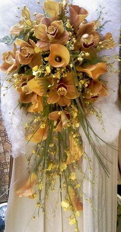 Using the red and white Moon Orchid and the yellow orchids from the bridesmaids with plain white orchids and the green grass shown here.