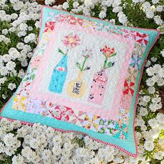 lovely little handmades: Flowers in Vintage Bottles quilted pillow