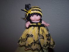 # 705 Gold/Black lace with bee buttons and matching hat