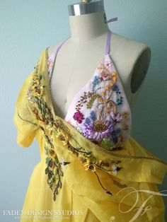 A couture, screen accurate replica of the Dornish dress worn by Myrcella Baratheon in HBOs Game of Thrones season 5. It is a 2 piece ensemble:   -The pink inner halter dress is made of lightweight, hand dyed cotton organdy. The cups are lightly lined.  -The outer yellow dress is also made from a lightweight, hand dyed cotton organdy with a lace up closure in back. All of the embroidery and bead-work is hand done, in studio.  - If you are interested in having any of the other Dorne dresses…